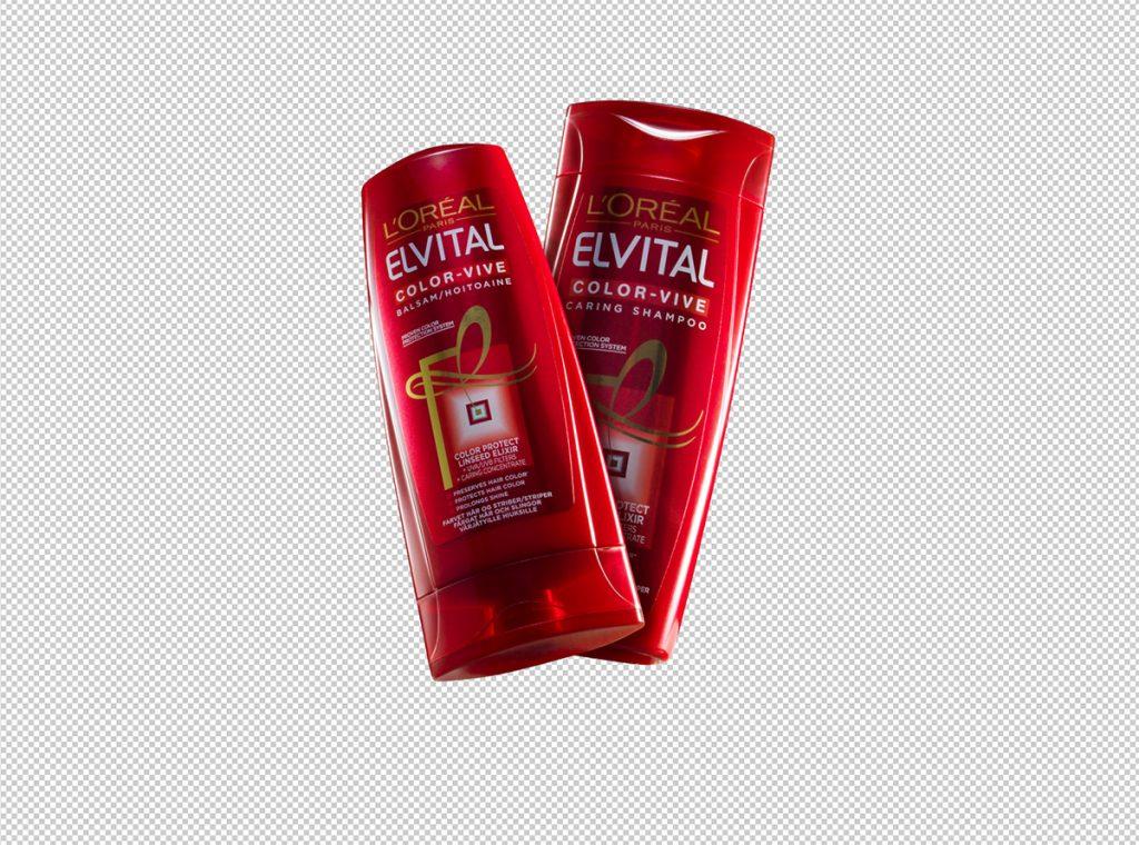 Frilagda flaskor till reklambild för shampoo och balsam, uppljusade med ett kurvlager