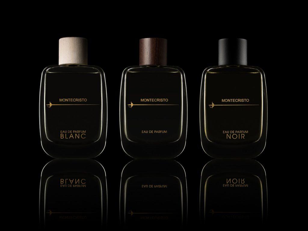 Montecristo parfymflaskor mot mörk bakgrund